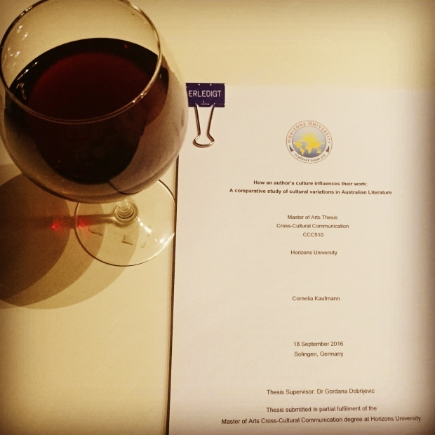 Master Thesis and a glass of red wine. As it says on the clip: Erledigt! (Done!) ©Literati Girl