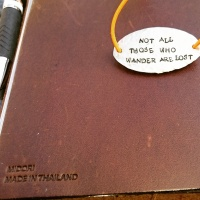 """Clasp on my Midori Traveler's Notebook: My favourite quote by J.R.R. Tolkien. """"Not all those who wander are lost"""" ©studyreadwrite"""