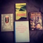 #bookishscavengerhunt16 Day 13: Foreign Editions. As I'm bilingual with German as my native language, I have many books in English and German. These are German copies of The Never-ending Story by Michael Ende, The Hobbit by J.R.R. Tolkien, Harry Potter and the Philosopher's Stone by J.K. Rowling, and my 1960s copy of The Complete Fairytales by Bros. Grimm. #foreignbooks #germanbooks #foreignlanguage #grimmsfairytales #Bookstagram ©theliteratigirl